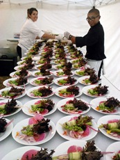 Chefs Ashley Campos and Chris Padre prepare a salad